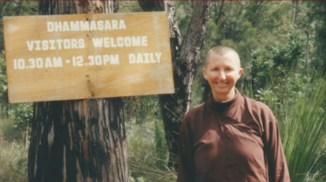 Ajahn Vayama and the original opening hours sign in 2000.
