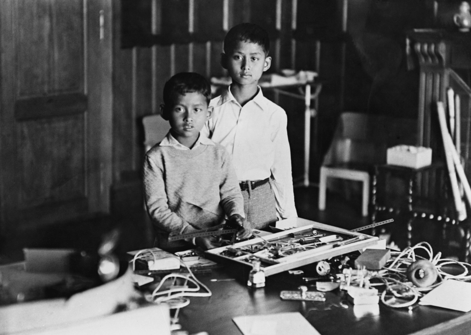 Ten year old King Ananda Mahidol, the boy King of Thailand, right, photographed with his brother Bhumibol, while playing with presents he received on his tenth birthday, in Lausanne, Switzerland where he was staying - an exclusive picture taken on his birthday, September 22, 1935. (AP Photo)